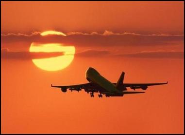 Aircraft in flight at sundown